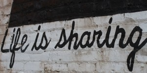 "Part of a Cleveland mural, the full saying was ""Life is sharing a park bench"""